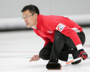 Jason Chang, Hong Kong's men's skip, watches his rock at the 2016 Pacific-Area Curling Championships (PACC) in Uiseong, South Korea. (Photo: World Curling Federation/Richard Gray).